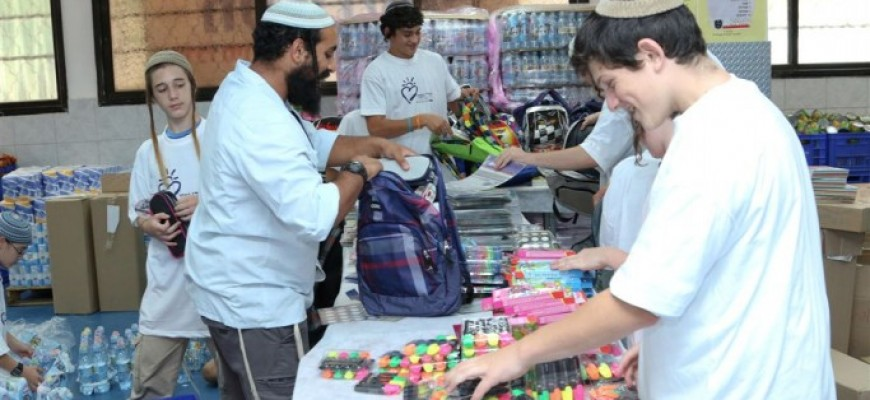 Thousands of School Bags and School Supply Kits Distributed by Chasdei Naomi